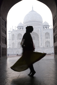 girl dancing in front of the Taj Mahal